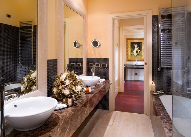 bathroom property sink mirror home hardwood Suite countertop living room flooring condominium wood flooring mansion Modern tiled