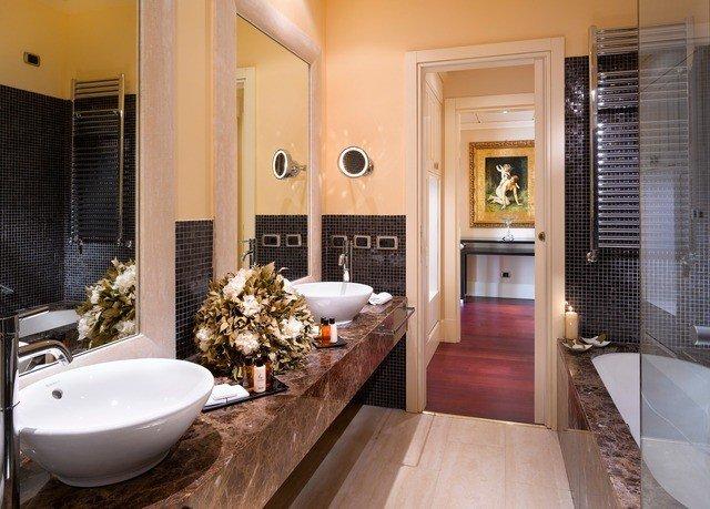 bathroom property sink mirror home hardwood Suite countertop living room flooring condominium wood flooring mansion Modern tiled