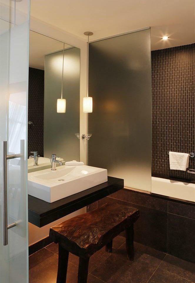 bathroom mirror sink property Suite lighting plumbing fixture home flooring counter Modern tile