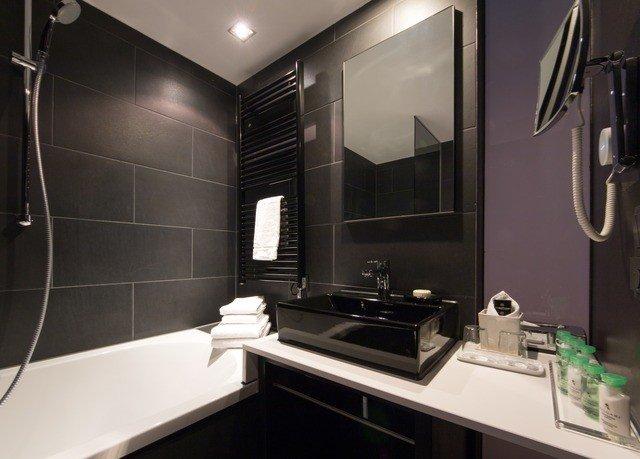 bathroom property sink home lighting counter Suite plumbing fixture Modern tiled