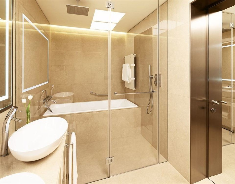 bathroom property sink toilet plumbing fixture shower public toilet Suite flooring Modern tan