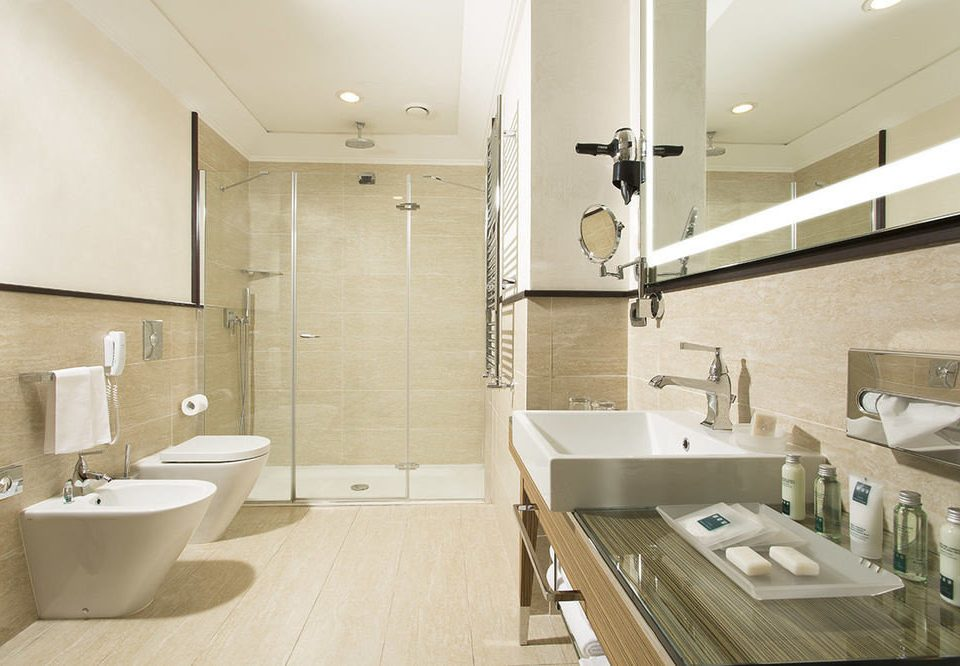bathroom sink mirror property toilet home flooring Suite Modern