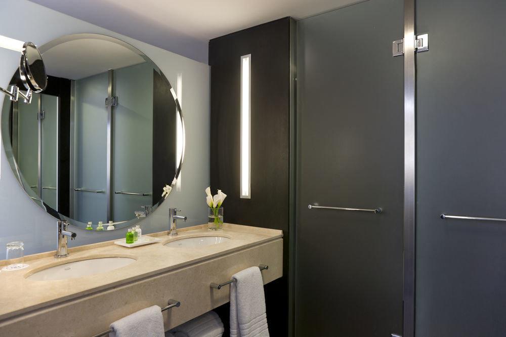 bathroom large sink mirror property shower home Suite plumbing fixture Modern toilet stall tan