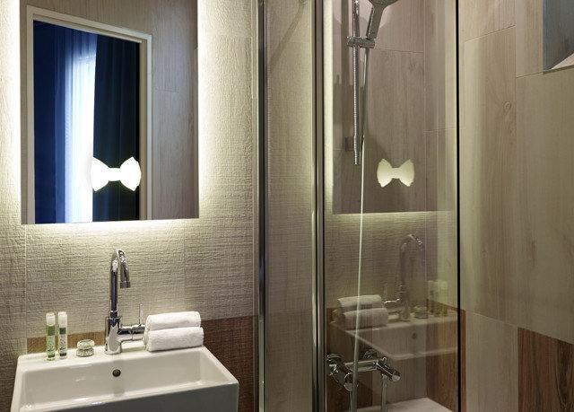 bathroom sink mirror toilet plumbing fixture Suite Modern