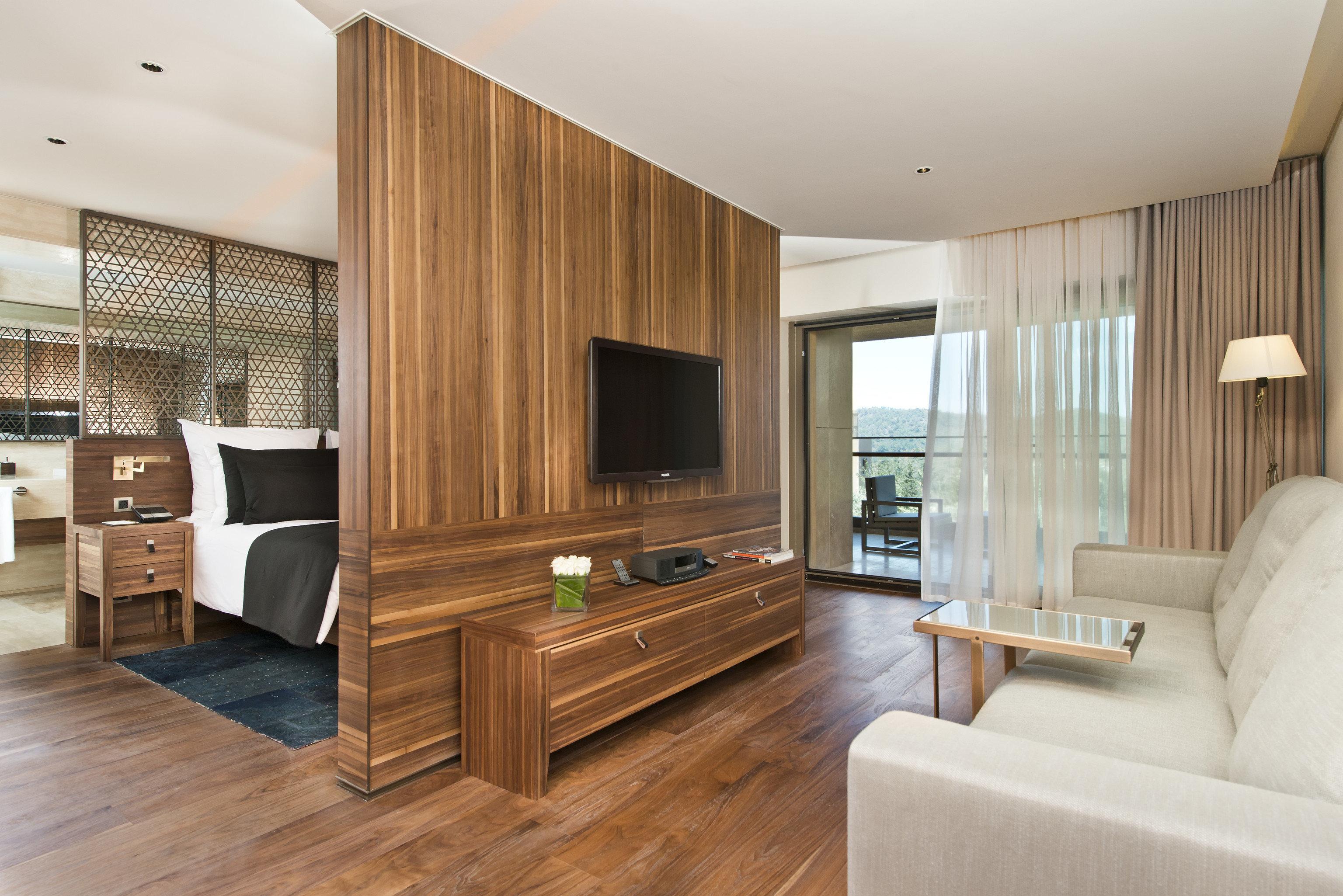 sofa property living room home hardwood wooden cabinetry condominium wood flooring Suite flooring flat hard Modern