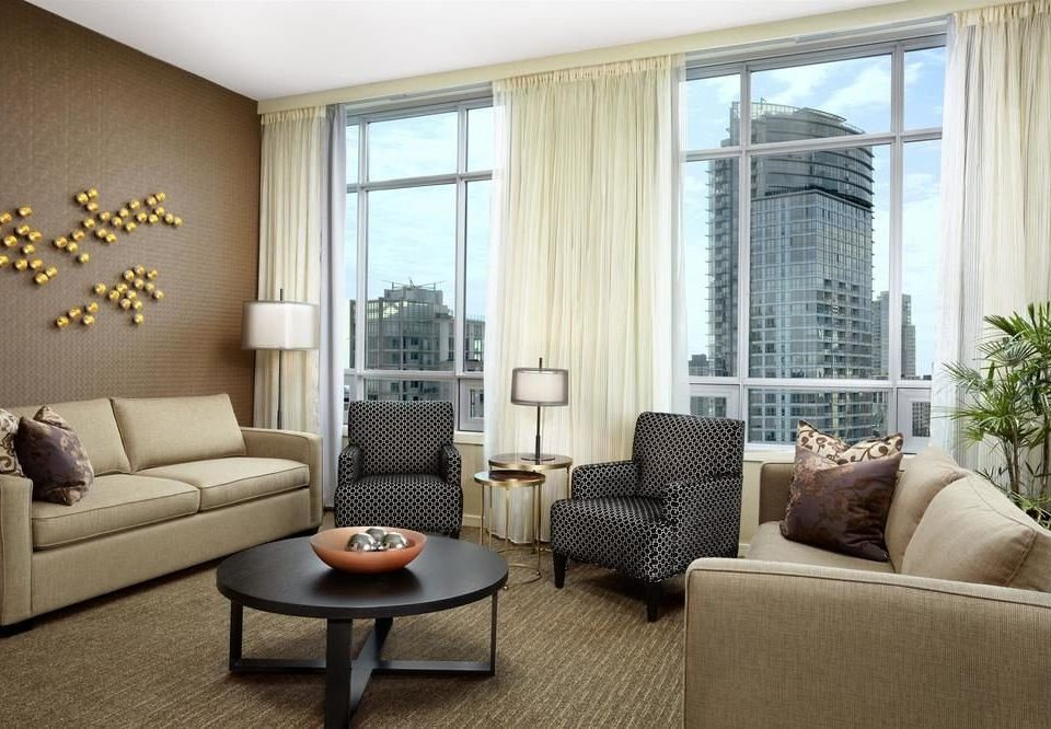 sofa living room property home condominium hardwood nice cottage Suite window treatment Modern
