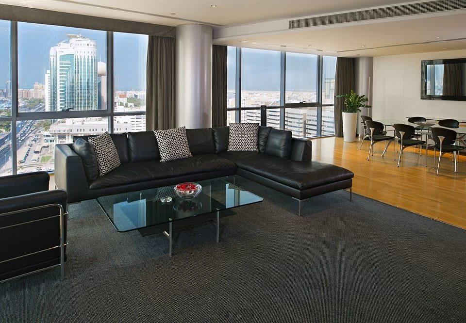 sofa property condominium living room home office recreation room Suite flooring Villa Modern