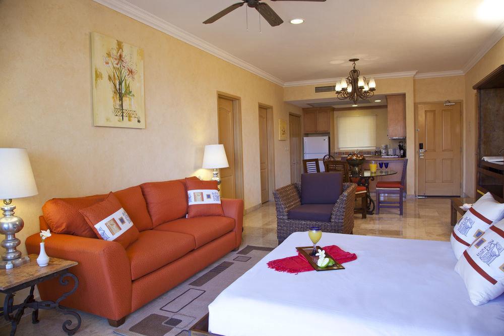 sofa property living room home orange cottage Suite Villa condominium flat Modern