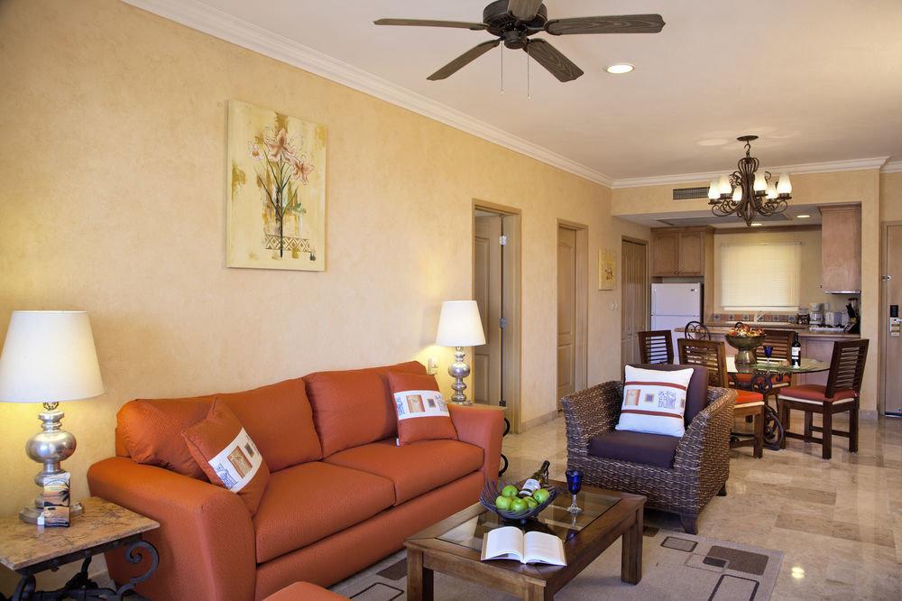 sofa property living room home cottage hardwood condominium Suite orange Villa leather lamp Modern