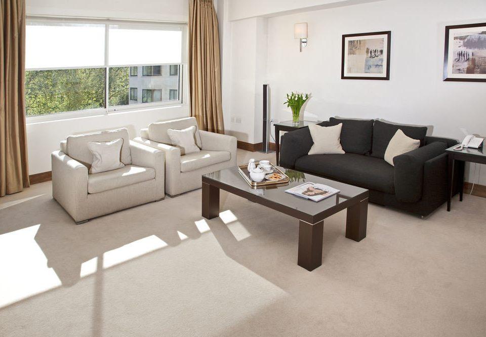sofa property living room home condominium cottage Villa Suite Modern