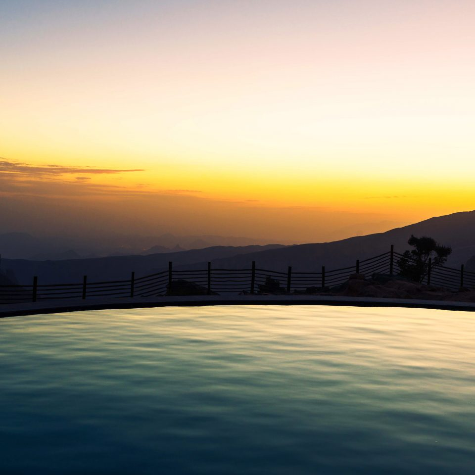Mountains Nature Outdoors Pool Resort Scenic views sky water Sunset sunrise afterglow Sun horizon dawn atmospheric phenomenon atmosphere scene morning dusk cloud setting evening Sea sunlight mountain clouds cloudy day