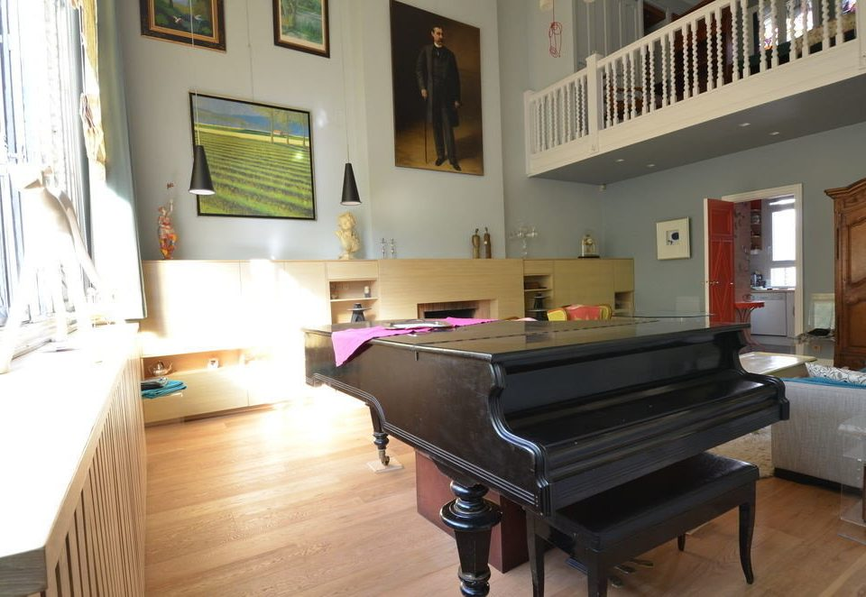 Music piano property hardwood living room black home cottage Villa keyboard string instrument technology musical instrument electronic device wood flooring leather