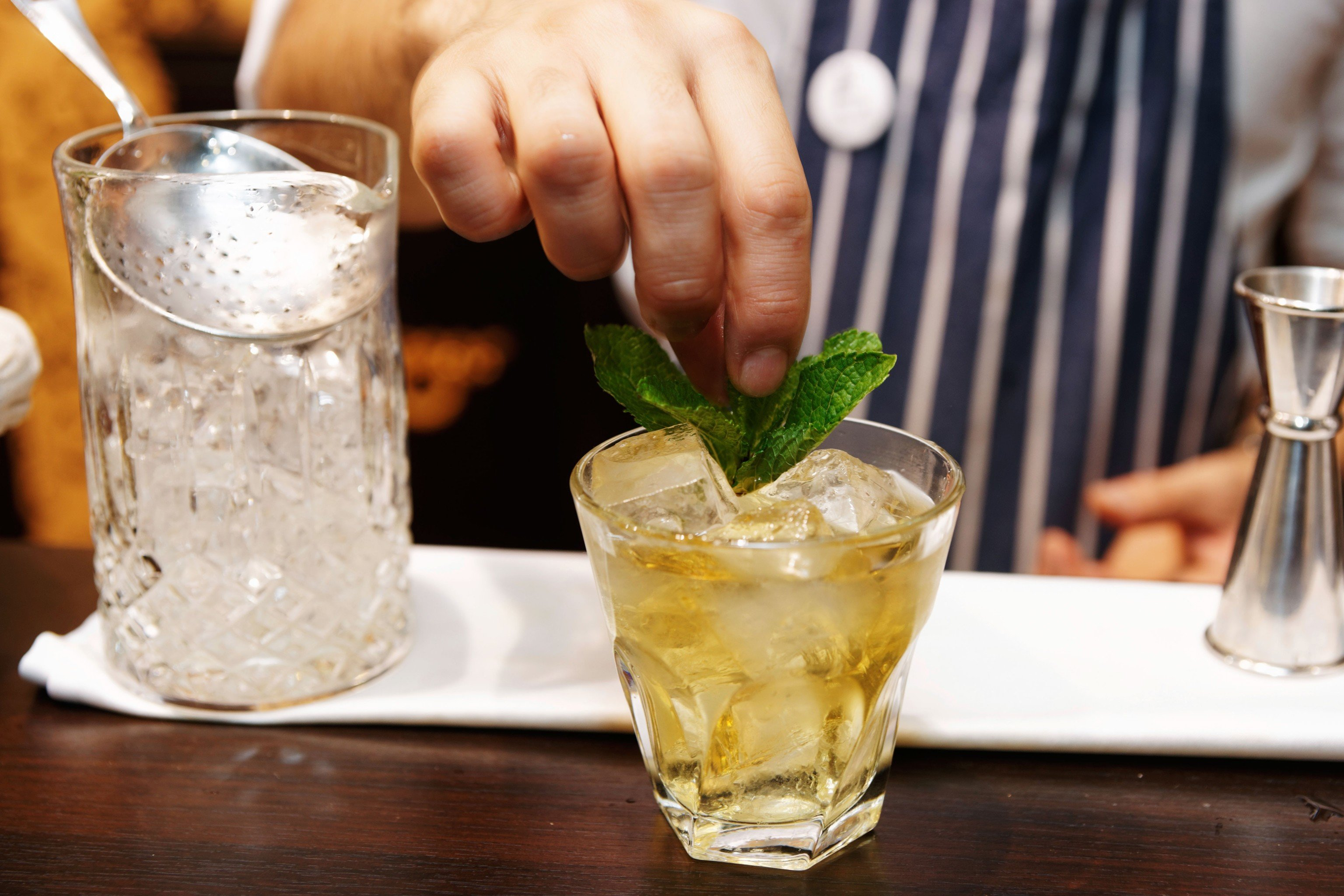 Food + Drink cup table person Drink alcoholic beverage cocktail glass mint julep distilled beverage liqueur food produce drinking