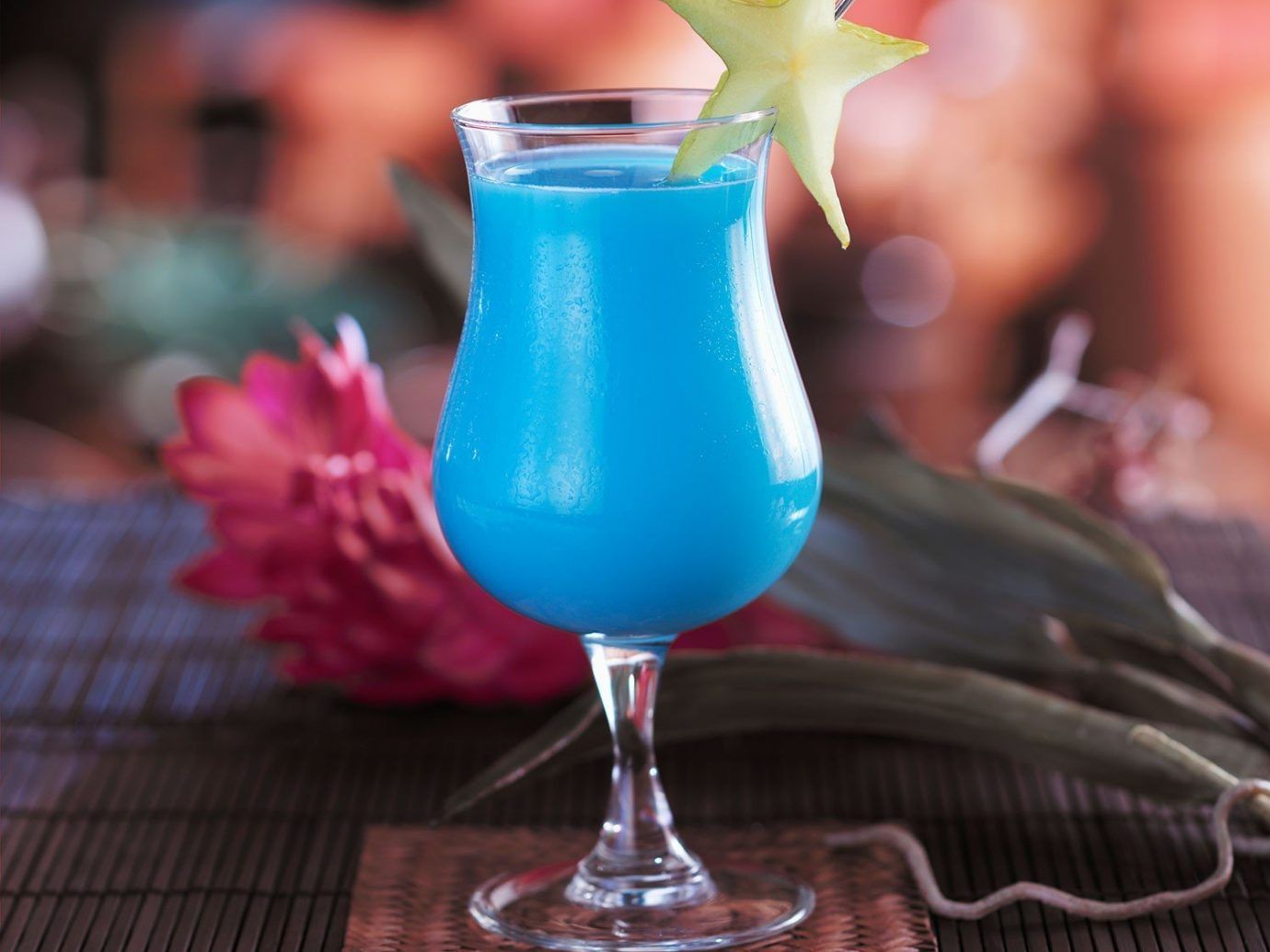 Offbeat table sitting indoor Drink alcoholic beverage cocktail food blue glass