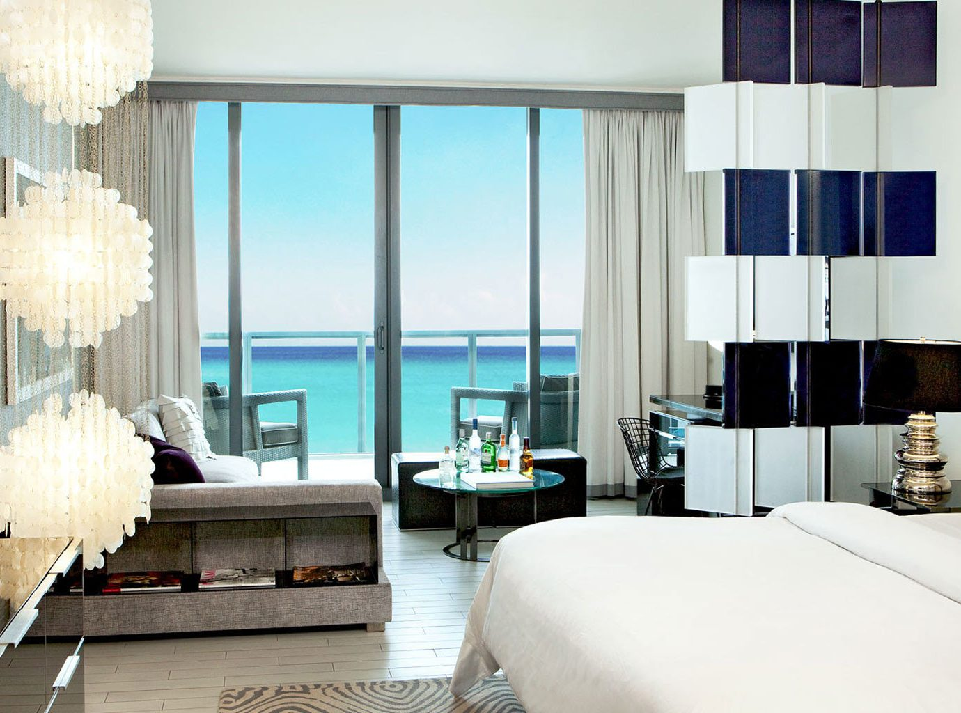 Beach bed Bedroom chic clean Hotels interior Luxury Ocean ocean view turquoise view indoor wall sofa room property Living Suite condominium interior design living room hotel estate home Design window covering furniture real estate curtain apartment Modern