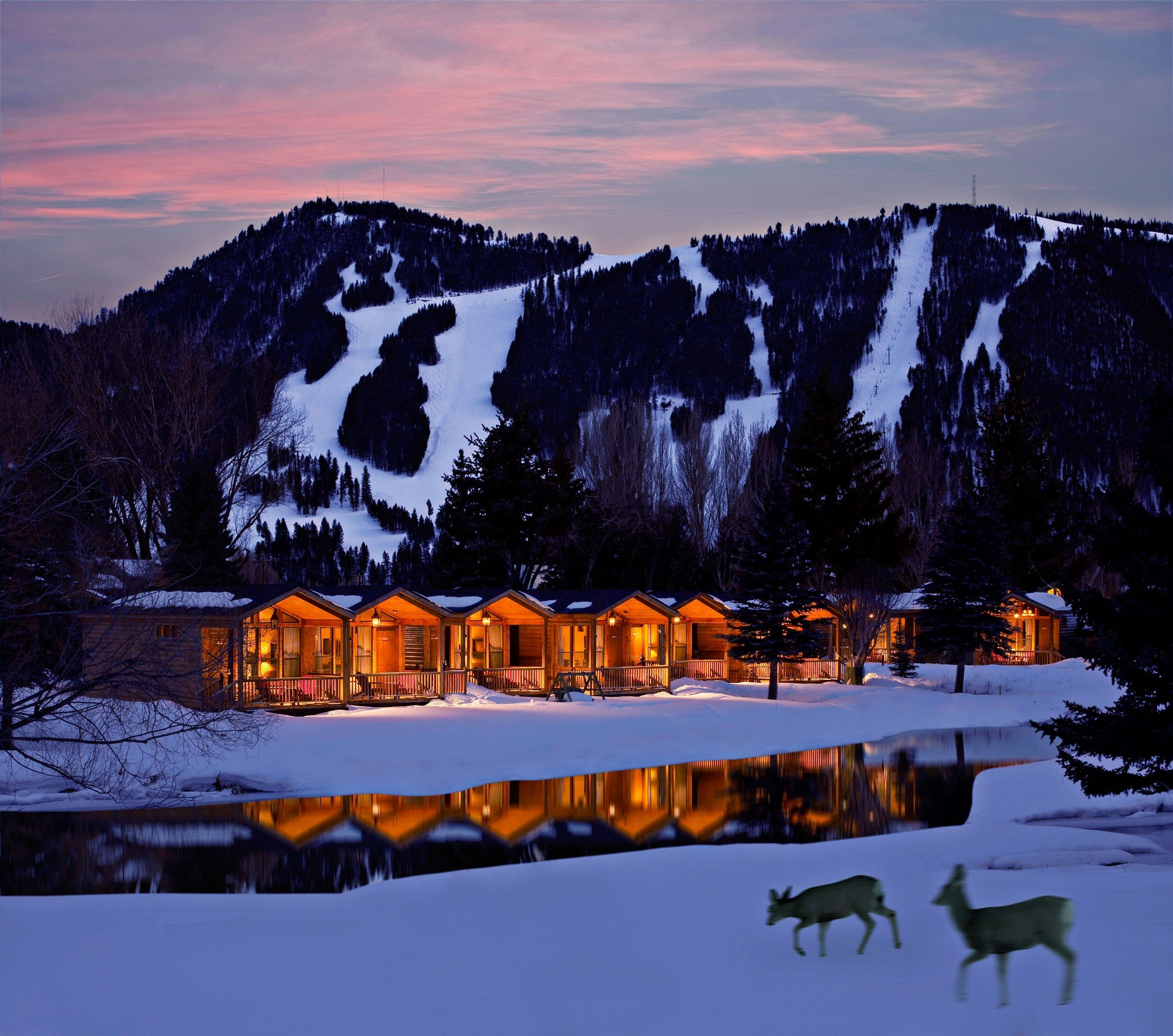 Hotels Trip Ideas snow outdoor sky tree mountainous landforms reflection Winter mountain Nature wilderness weather geological phenomenon season mountain range night evening cloud morning Sunset dusk dawn landscape sunrise Lake ice Forest