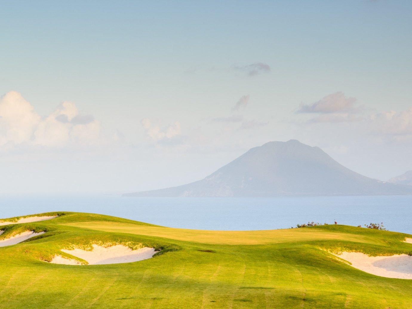 Hotels sky outdoor grass Nature mountain grassland geographical feature plain natural environment ecosystem horizon hill sport venue morning prairie steppe plateau landscape golf course meadow clouds day highland lush