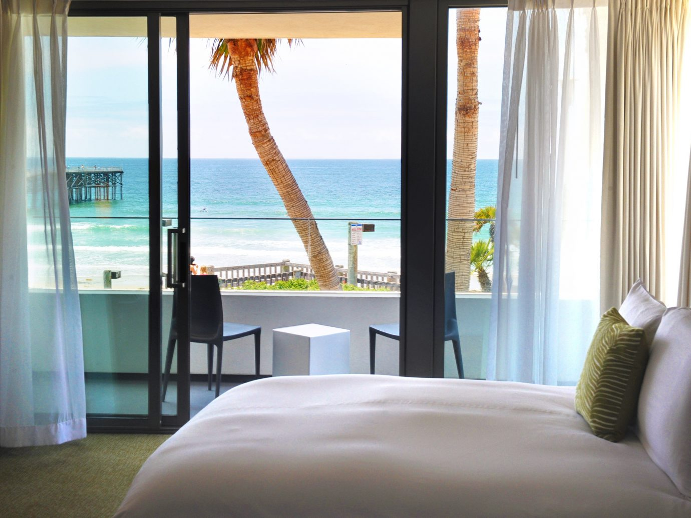Balcony Beachfront Bedroom Hotels Living Resort Scenic views indoor window bed hotel floor room property interior design home curtain Suite living room condominium nice estate window treatment window covering textile real estate apartment overlooking