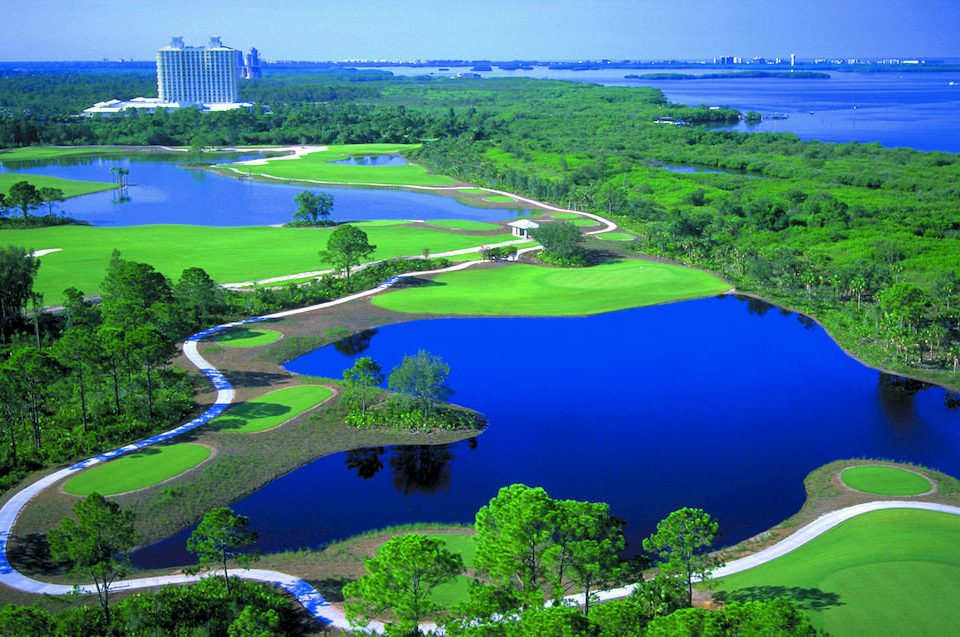 grass aerial photography bird's eye view structure Nature ecosystem sport venue green wetland golf course reservoir marsh estuary reef lush hillside surrounded