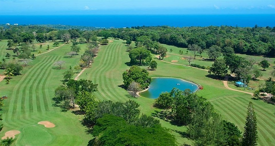 grass sky tree structure Nature ecosystem sport venue bird's eye view golf course aerial photography golf club field plain lawn lush shore hillside