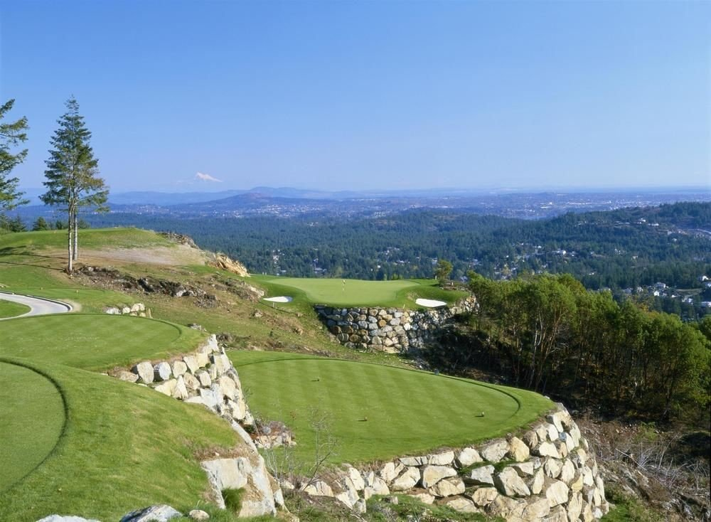 grass sky mountain green structure rock hill sport venue aerial photography mountain range grassy golf course Nature plateau sports hillside golf club lush overlooking stone highland