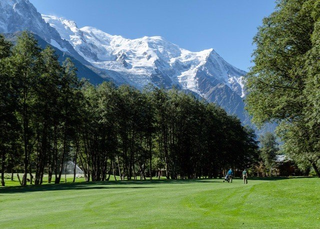 tree grass mountain sky structure field mountain range sport venue golf course outdoor recreation Nature meadow recreation park sports alps golf club lush distance highland