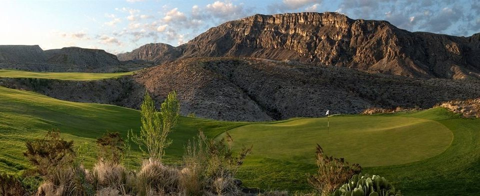 mountain grass sky Nature mountainous landforms valley canyon grassland badlands hill fell mountain range plateau landscape ridge hillside terrain golf course grassy panorama lush distance highland