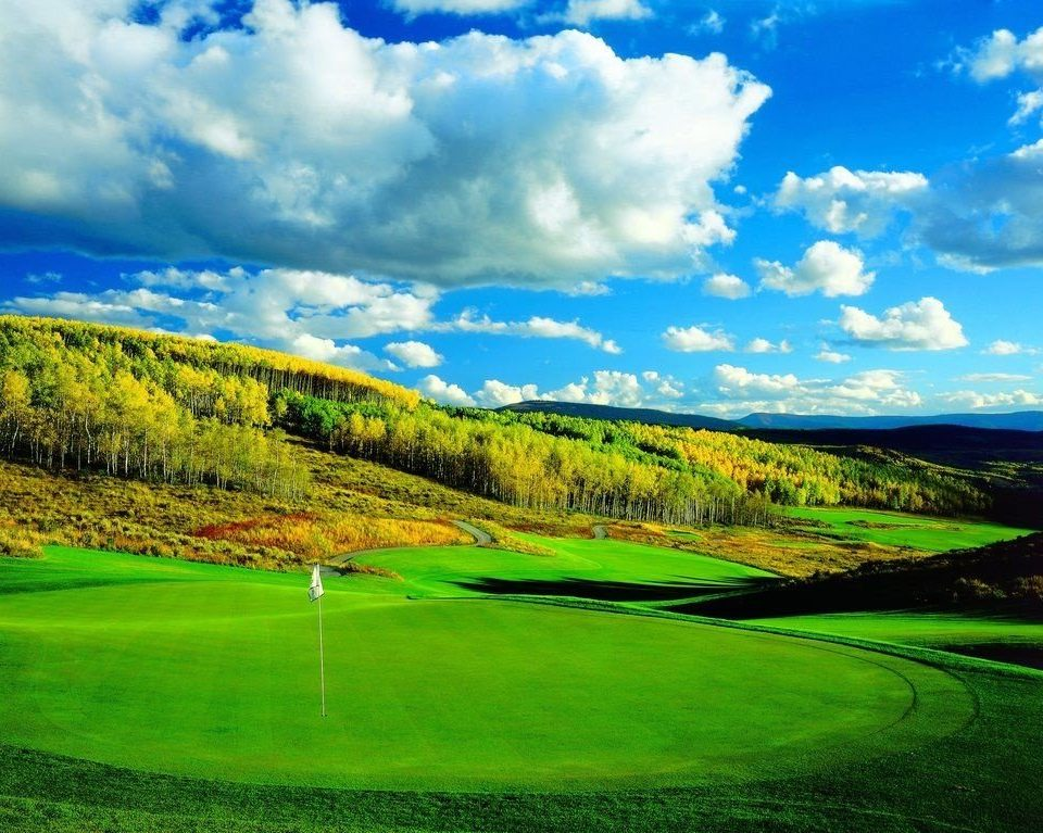 grass sky structure grassland green field sport venue pasture meadow plain golf course grassy mountain hill Nature golf club clouds prairie cloudy lawn lush day land highland
