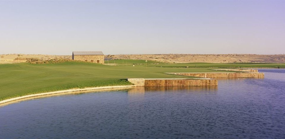 grass sky water structure Nature sport venue plain reservoir golf course golf club traveling shore land day