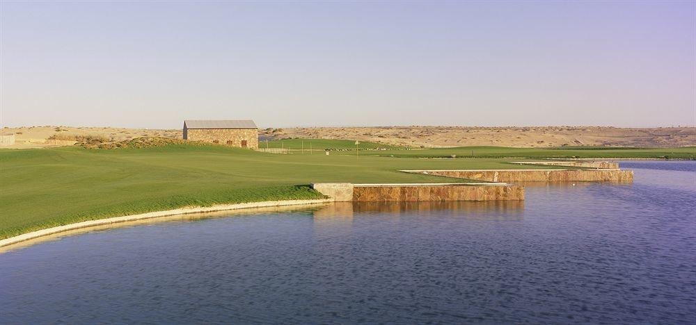 grass sky water structure Nature sport venue plain reservoir golf course golf club traveling shore land day