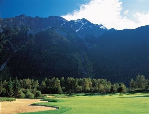 grass mountain sky tree mountainous landforms structure grassland mountain range sport venue Nature golf course golf club sports valley meadow plateau plain lush surrounded highland