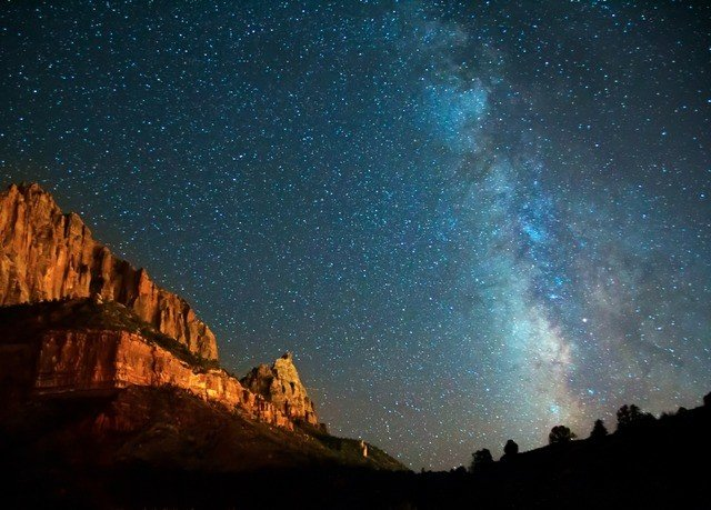 Nature sky galaxy mountain night astronomical object atmosphere astronomy star milky way spiral galaxy outer space day Night Sky