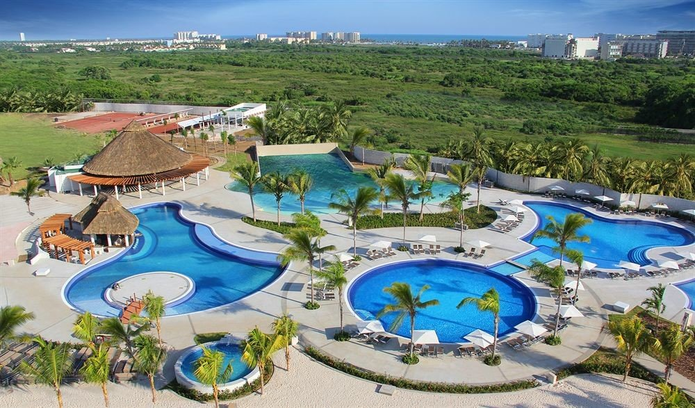 Pool Resort Tropical sky grass amusement park Water park Nature leisure park swimming pool outdoor recreation blue recreation resort town nonbuilding structure colorful set