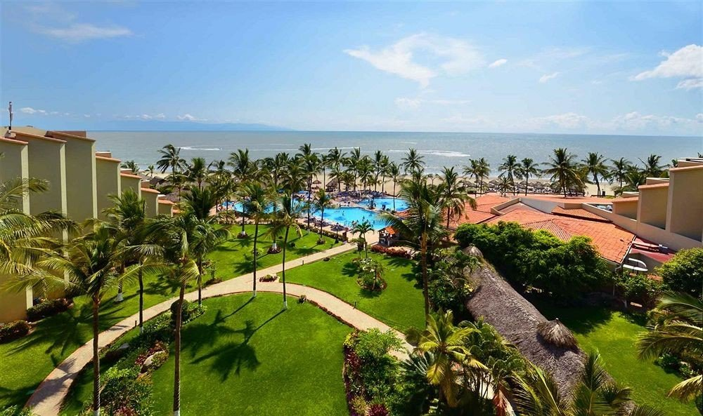 sky grass property Resort Villa residential area Nature condominium Village mansion plant tree shore lush