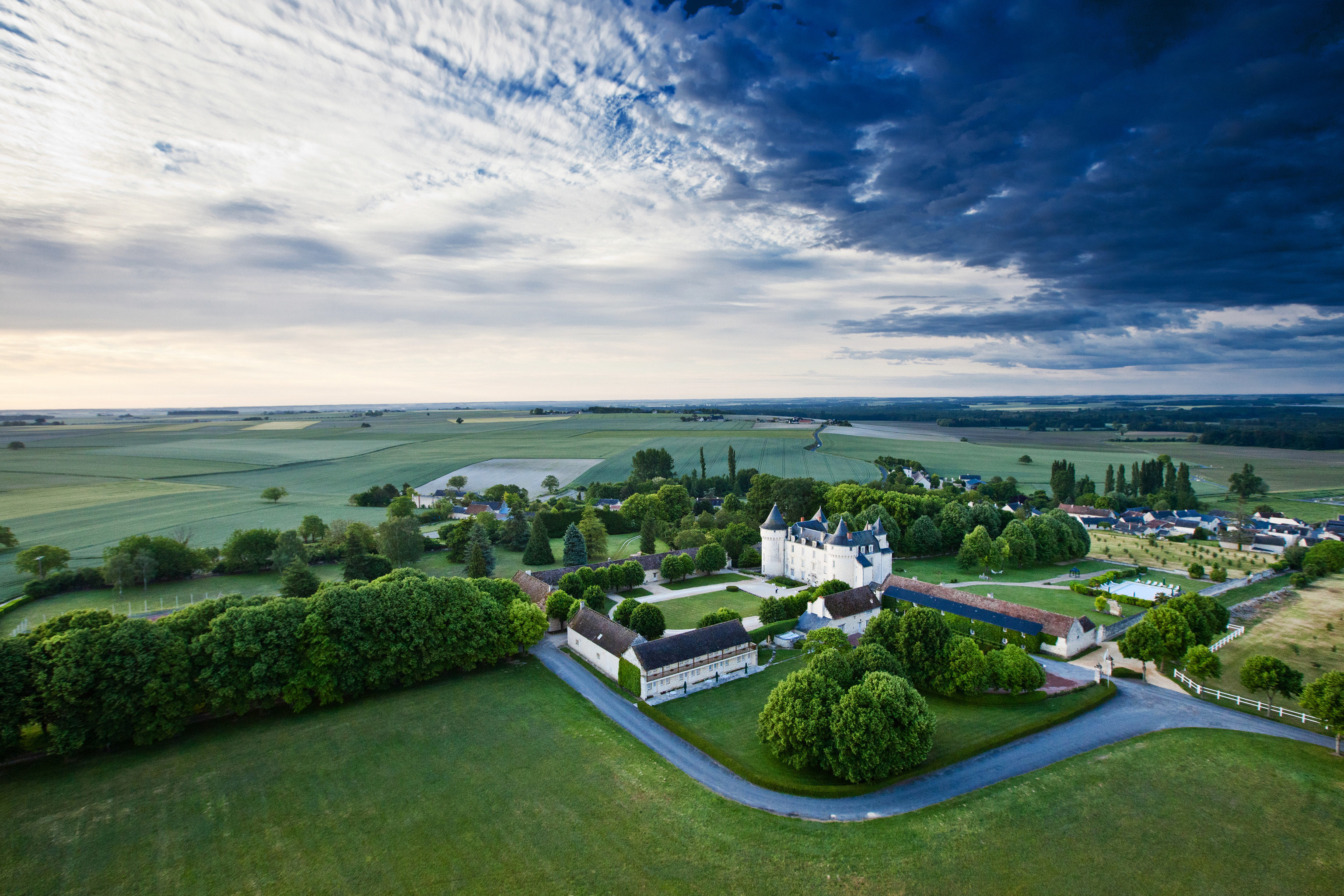 grass sky aerial photography horizon photography cloud Nature bird's eye view residential area atmosphere of earth sport venue hill rural area landscape green Sea shore