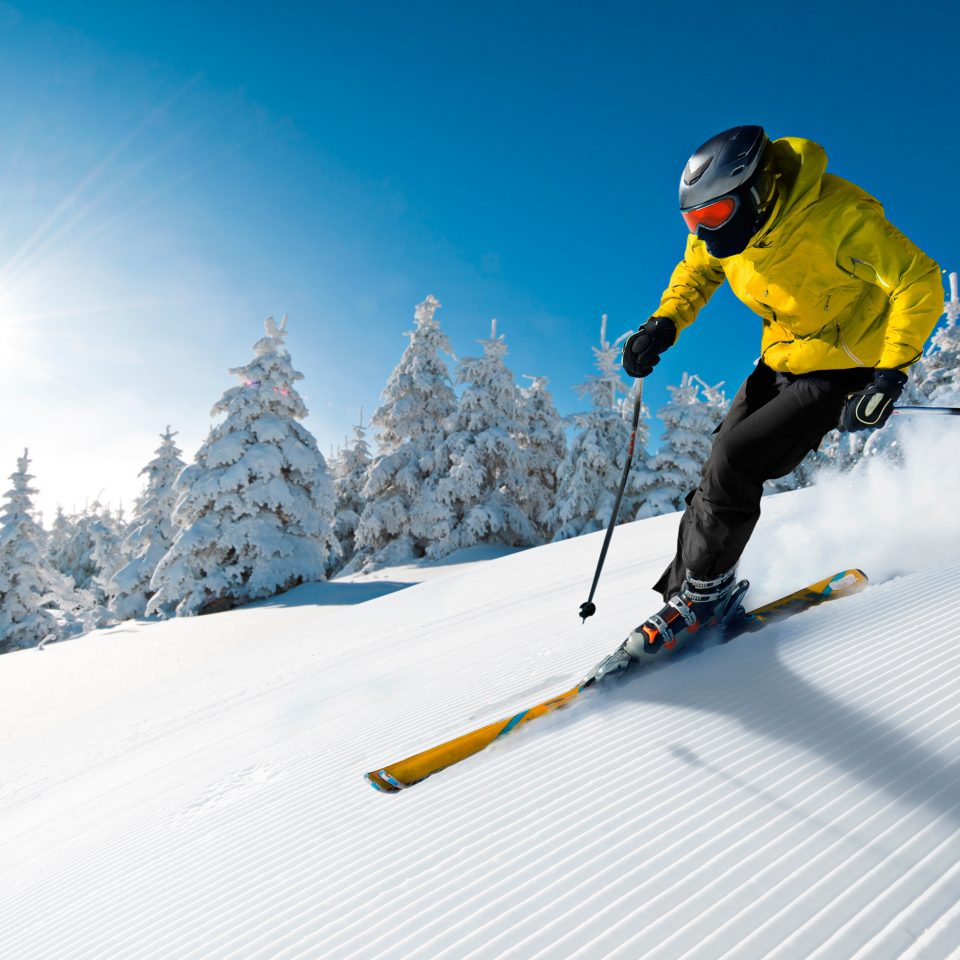 snow yellow sky skiing winter sport slope telemark skiing alpine skiing Nature Ski hill ski cross ski equipment downhill sports nordic combined footwear outdoor recreation piste nordic skiing jacket recreation extreme sport ski mountaineering ski touring sports equipment slalom skiing snowboard freeride coat ski slope