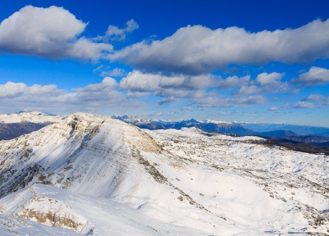sky snow Nature mountainous landforms mountain mountain range weather Winter geological phenomenon cloud piste season ridge alps plateau slope clouds summit arctic day