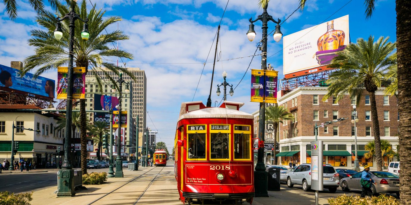 Girls Getaways New Orleans Travel Tips Trip Ideas Weekend Getaways tree outdoor sky vehicle metropolitan area bus land vehicle transport street yellow neighbourhood red public transport tram residential area cable car way sidewalk