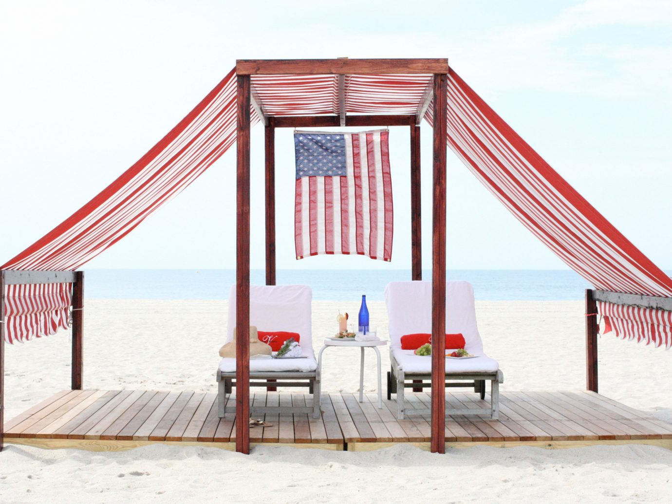 Beach Beachfront Boutique Deck Lounge Ocean Patio Trip Ideas Waterfront Weekend Getaways sky outdoor bed chair tent canopy Play outdoor play equipment interior design furniture day sandy