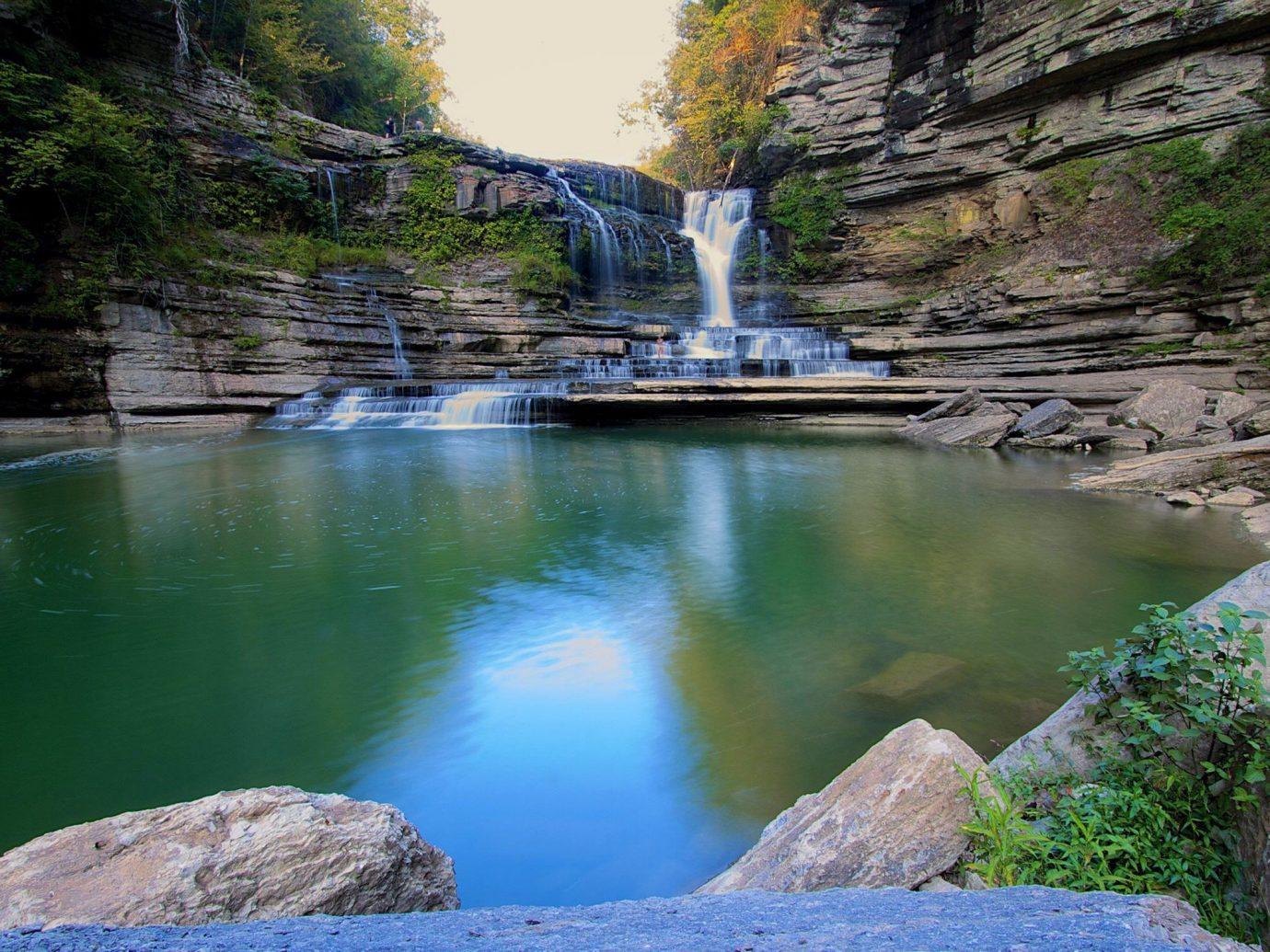 Outdoors + Adventure outdoor rock Nature tree Waterfall water body of water wilderness water feature River reflection Lake stream park valley surrounded pond stone hillside