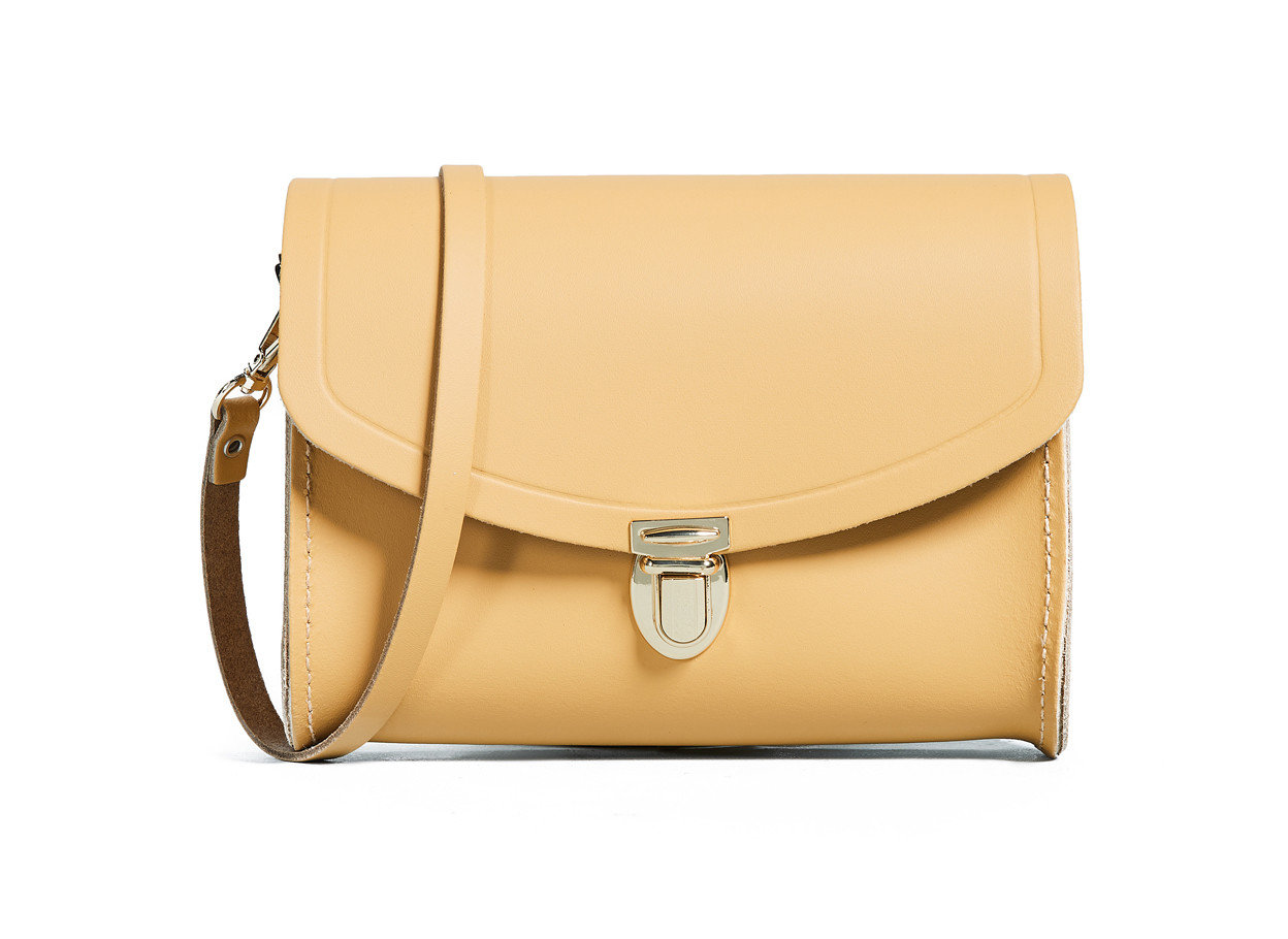 Food + Drink Romantic Getaways Weekend Getaways yellow bag shoulder bag fashion accessory beige handbag product leather product design brand