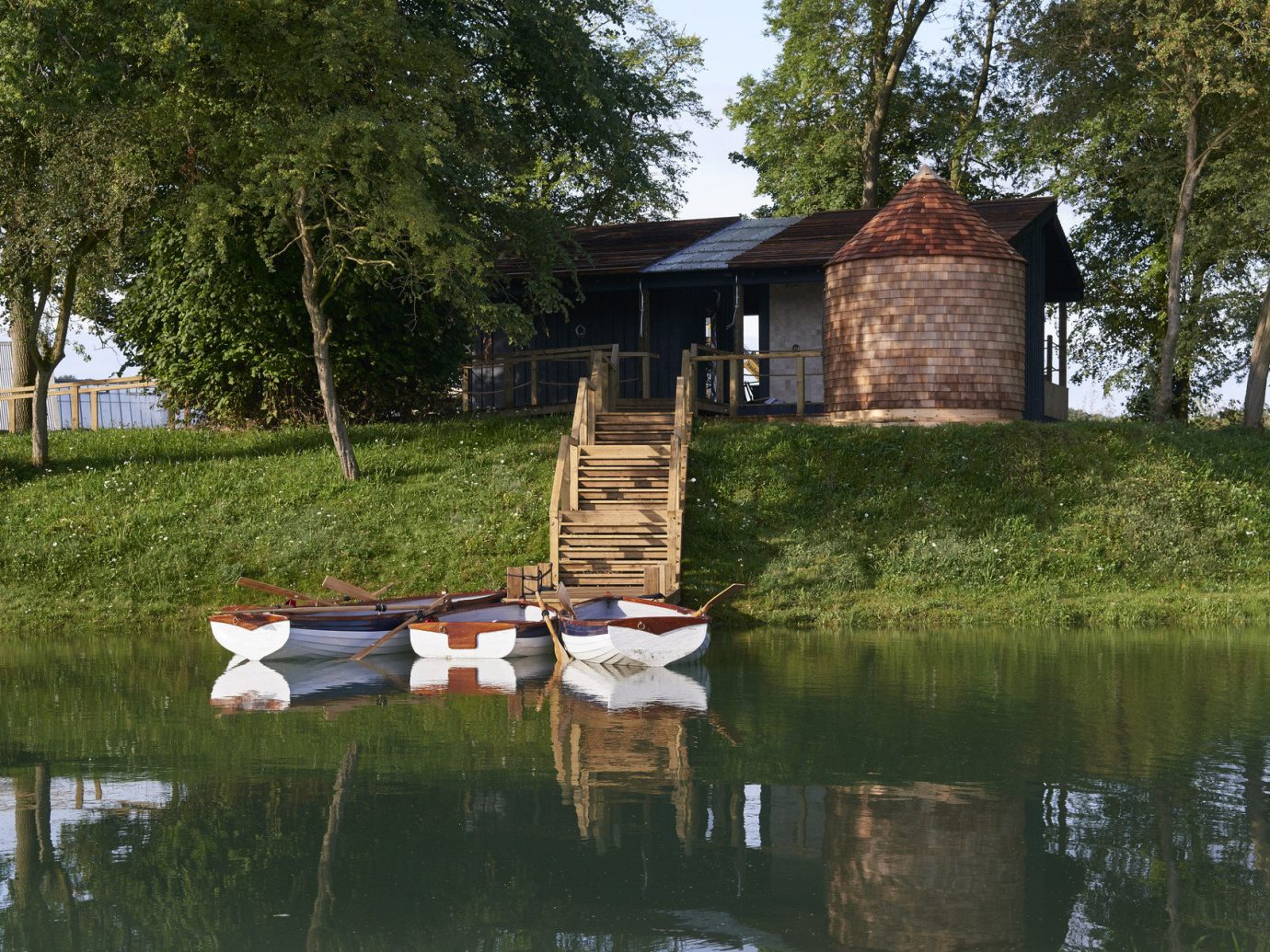 Hotels water tree outdoor grass Lake pond River house Nature rural area waterway surrounded swimming