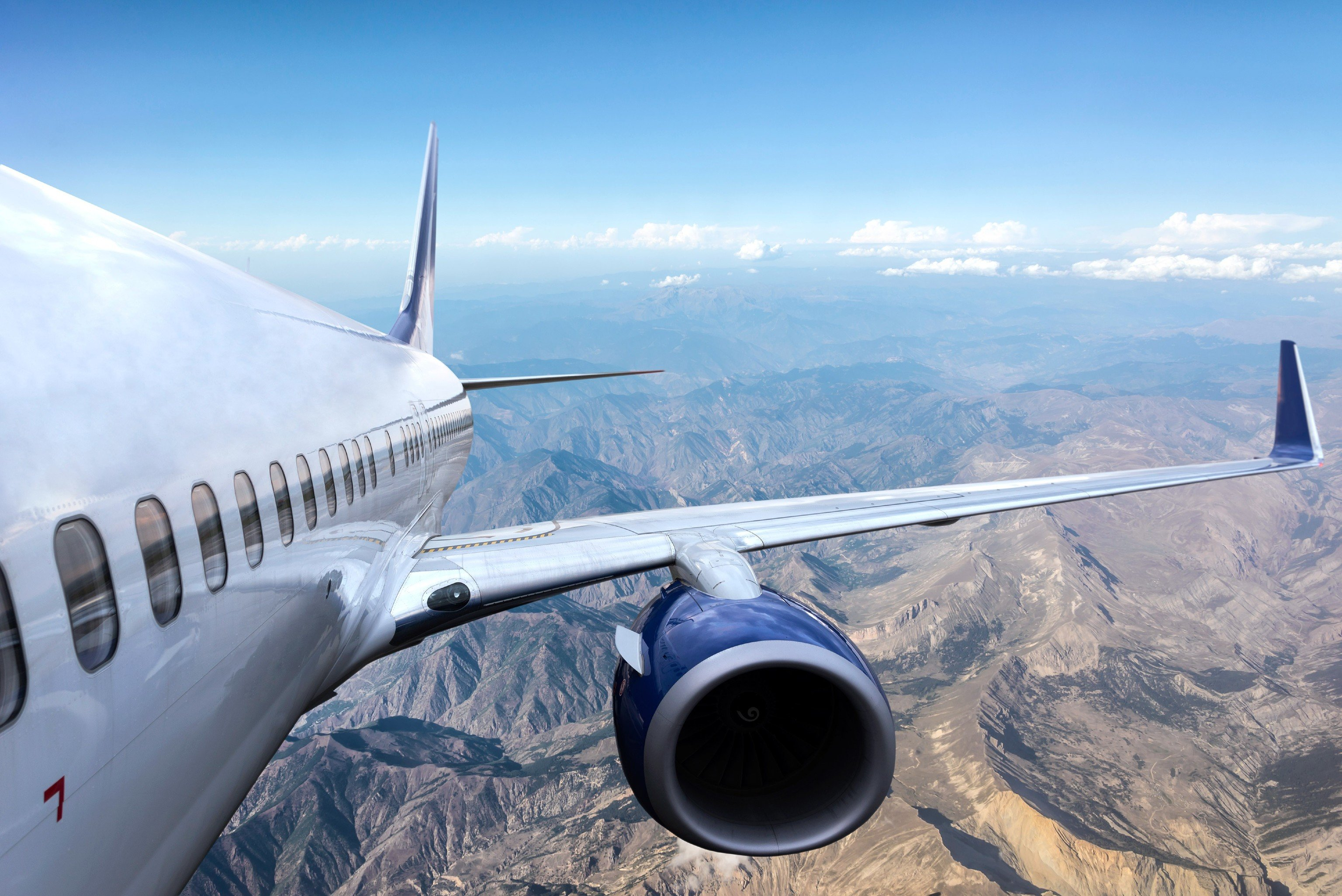 Flights Travel Tips plane mountain sky airplane outdoor airline vehicle airliner air travel aircraft aviation flight air atmosphere of earth runway wide body aircraft jet aircraft air force takeoff aerospace engineering boeing jet boeing 737 narrow body aircraft airbus aircraft engine wing boeing 787 dreamliner boeing 767 airbus a330 engine tarmac day