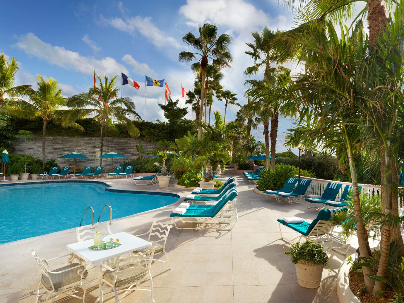 Hotels Living Lounge Luxury Pool tree outdoor sky leisure swimming pool property Resort Beach palm caribbean vacation estate condominium lined real estate Villa lawn Water park tropics arecales sandy shore day several