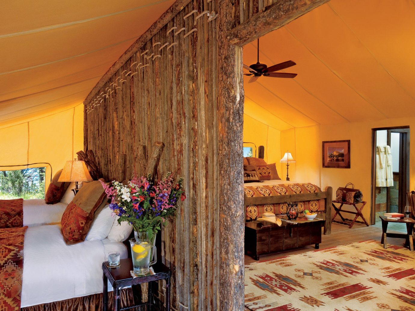 Glamping Hotels Luxury Travel Montana Outdoors + Adventure Trip Ideas indoor Living room wall floor sofa property ceiling estate furniture house living room cottage Villa home farmhouse decorated interior design real estate Bedroom mansion Suite