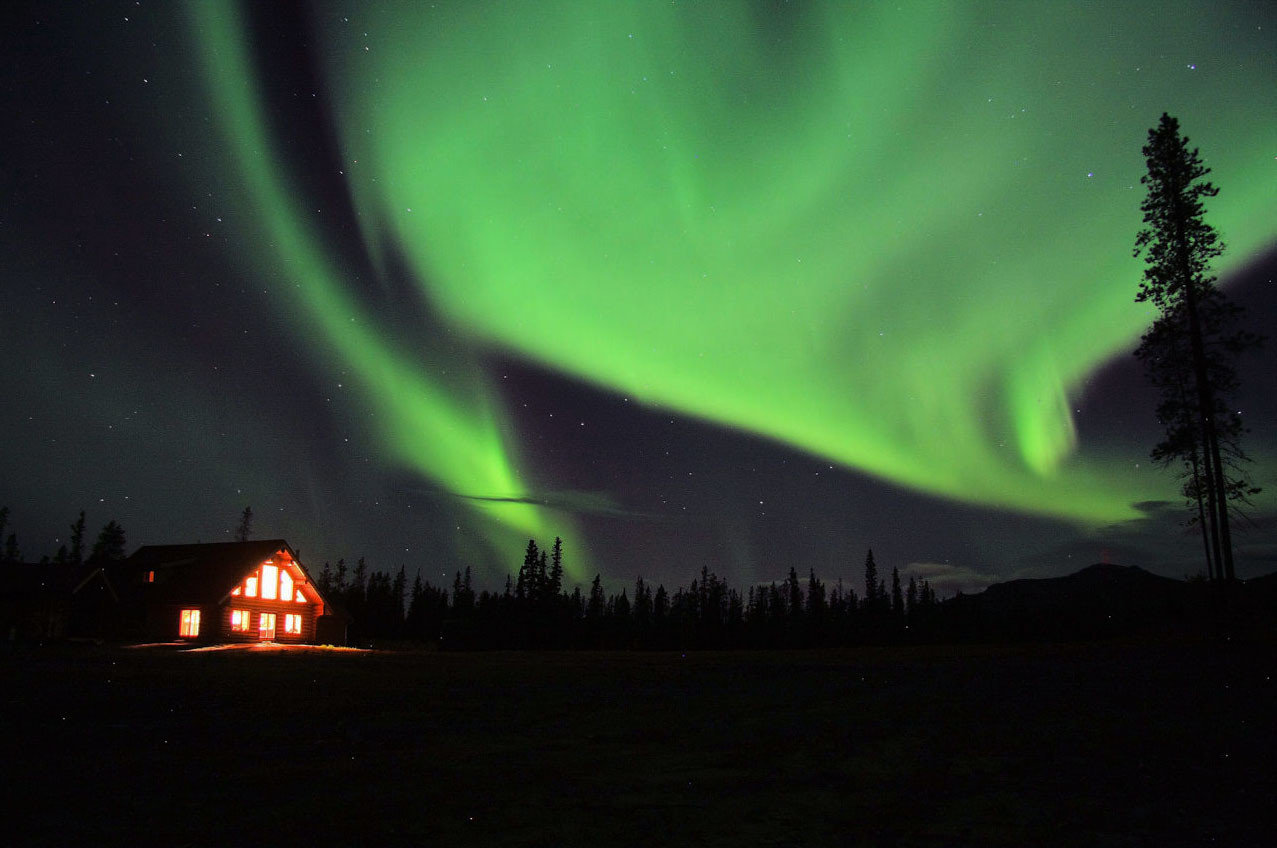 Cabin calm colorful house isolation lights majestic neon night night lights Night Sky northern lights remote serene trees Trip Ideas wilderness outdoor aurora light darkness atmosphere midnight dark bright