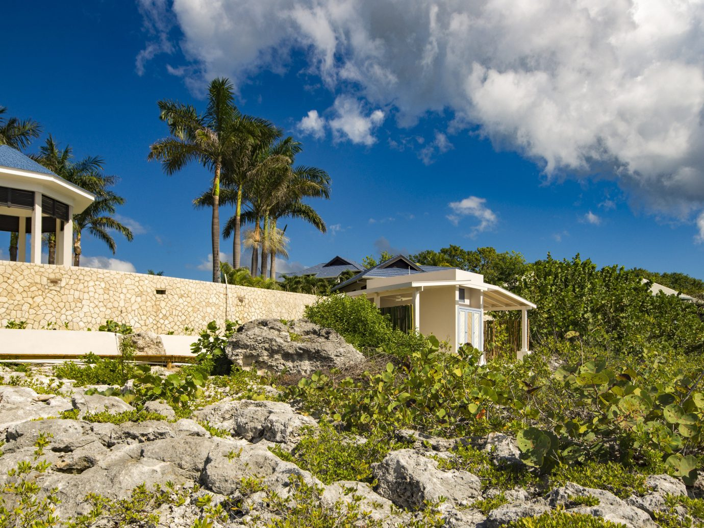 Hotels outdoor sky grass building tree Sea vacation Coast Ocean house estate cloud Beach landscape rural area arecales bay caribbean