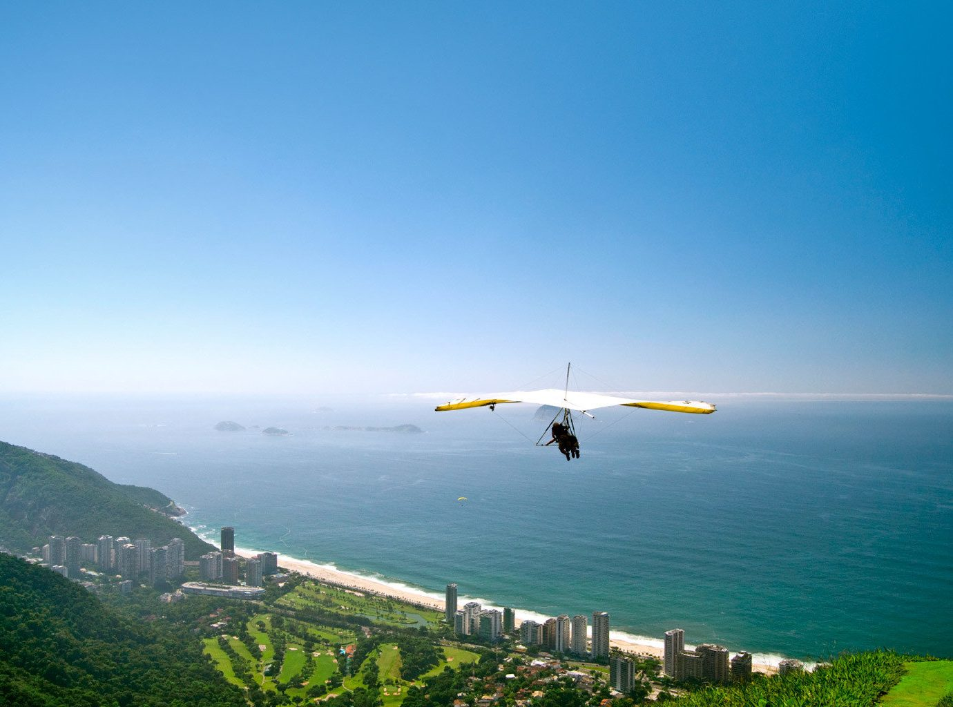 Trip Ideas sky outdoor water Nature flight air sports aircraft horizon atmosphere of earth mountain vehicle gliding Ocean airplane aviation Adventure wing Sea windsports land promontory hillside shore