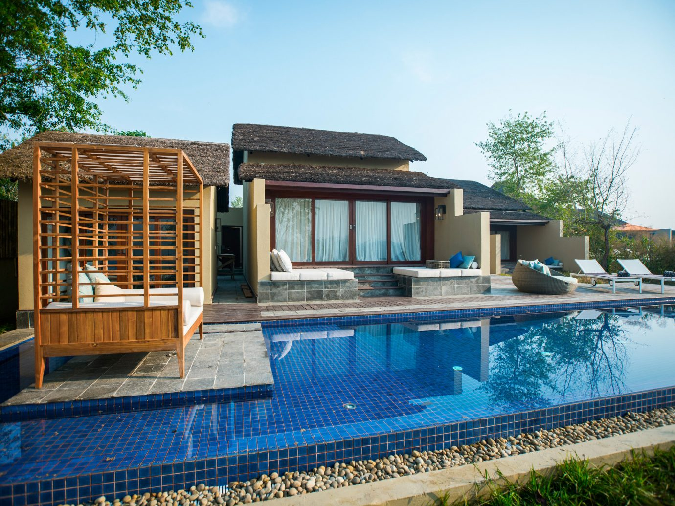 Hotels Safari sky tree outdoor swimming pool building property house estate Villa backyard Resort home real estate facade condominium outdoor structure cottage mansion