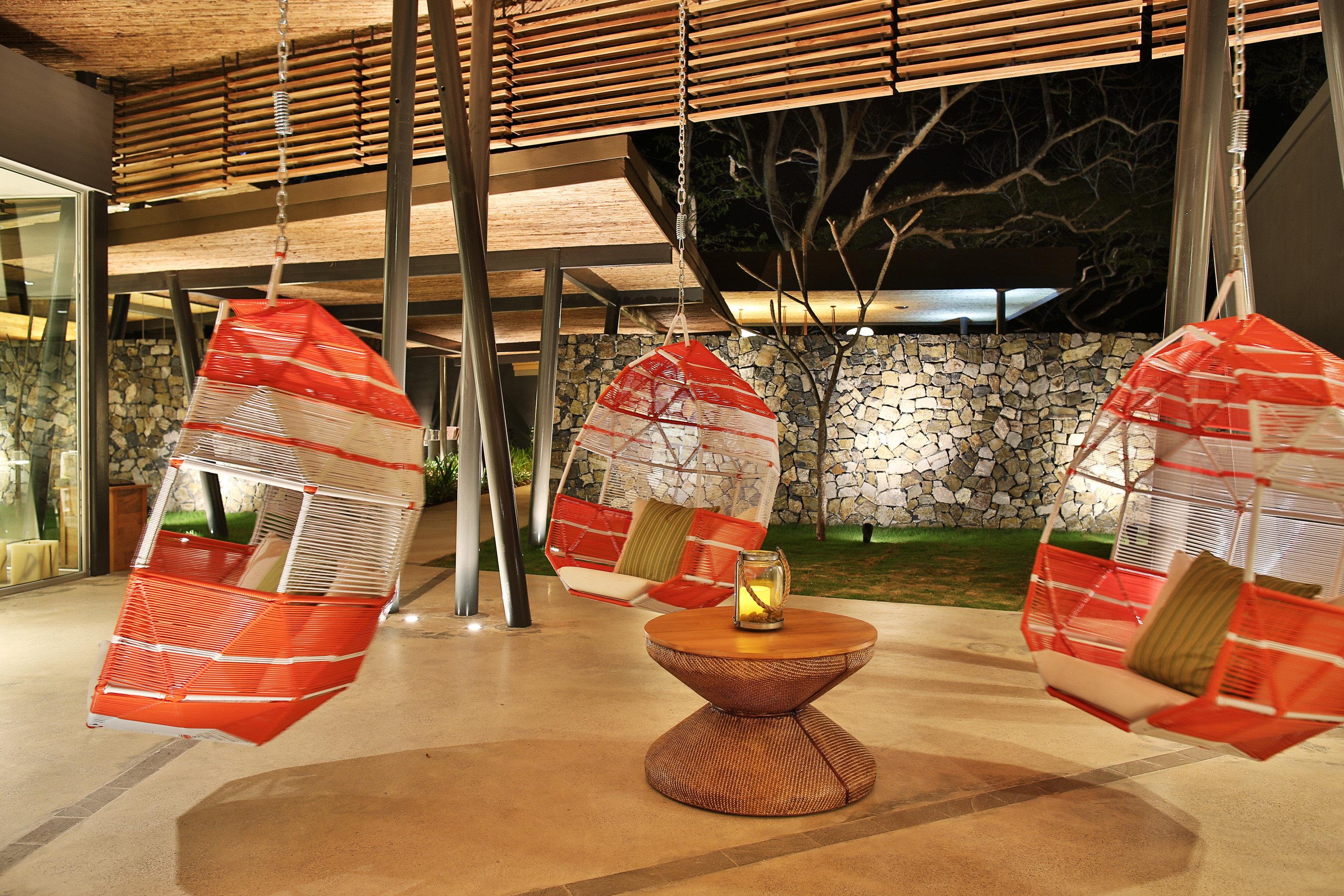 Beachfront Boutique Drink Elegant Hip Hotels Lounge Play Waterfront red interior design tourist attraction orange